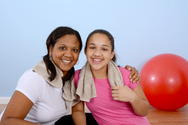 mother and daughter with exercise ball